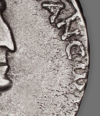 Detail showing the truncated letters at the beginning of the inscription on the reverse of Tetradrachm (Coin) Portraying Queen Cleopatra VII (37/33 B.C.). The Art Institute of Chicago